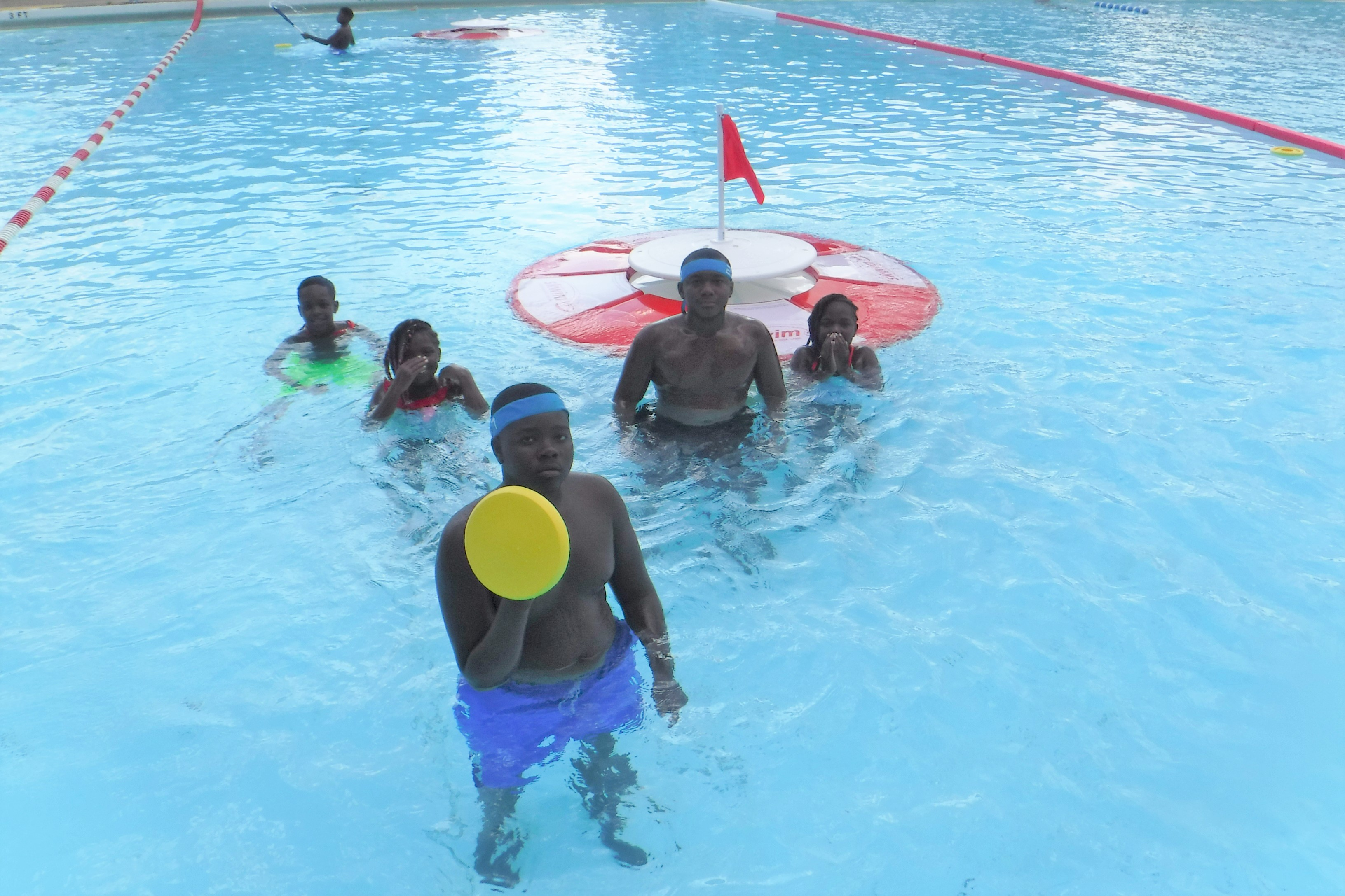 Kids, older and younger, as well as adults, all are able to play SKWIM together. Photo from Citiparks Ammon pool shows how we can just use part of the water for the game.